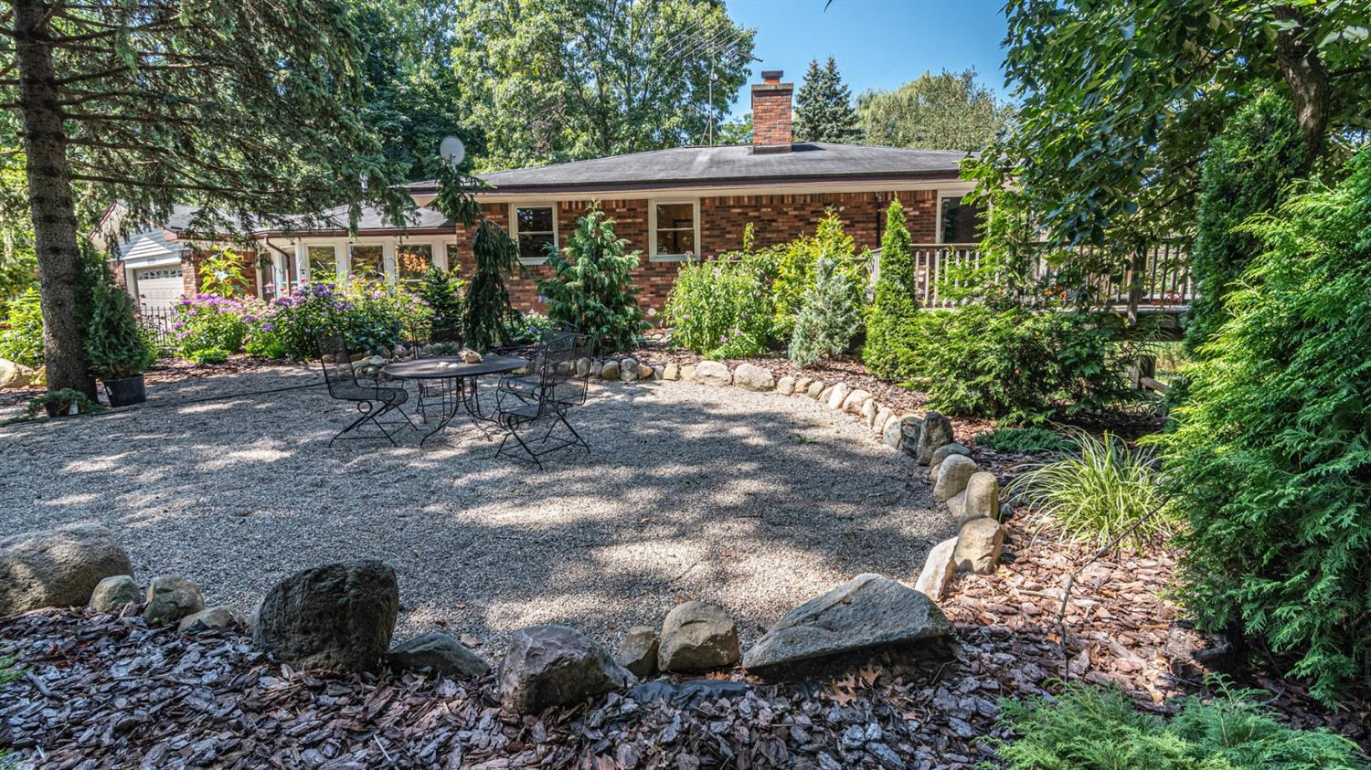 gorgeous backyard patio at 8220 n warner rd, a saline country home